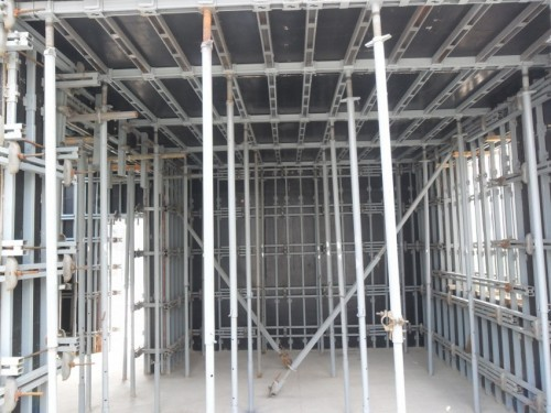 Adjustable scaffolding and formwork building system for wall